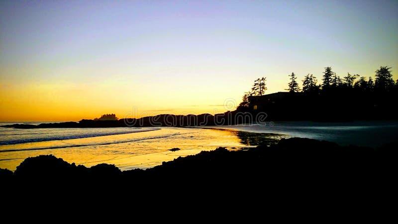 Puesta del sol en la playa de Tofino fotos de archivo