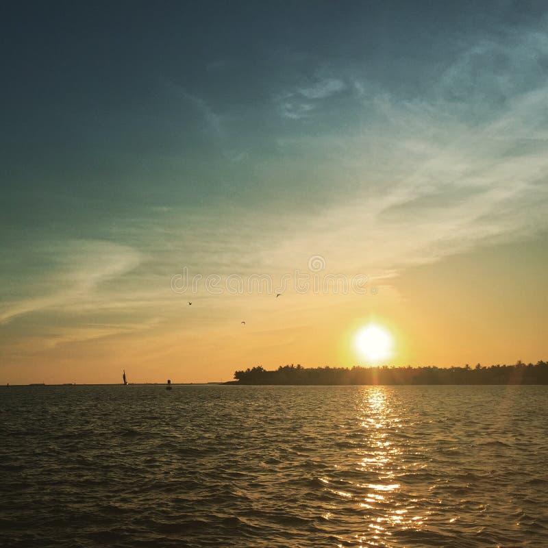 Puesta del sol en llave fotos de archivo