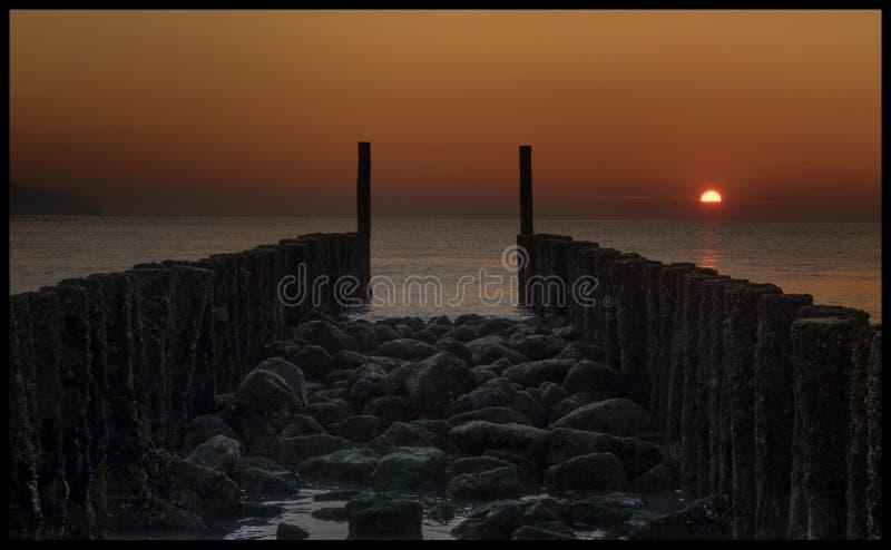 Puesta del sol en Zelanda, los Países Bajos foto de archivo libre de regalías