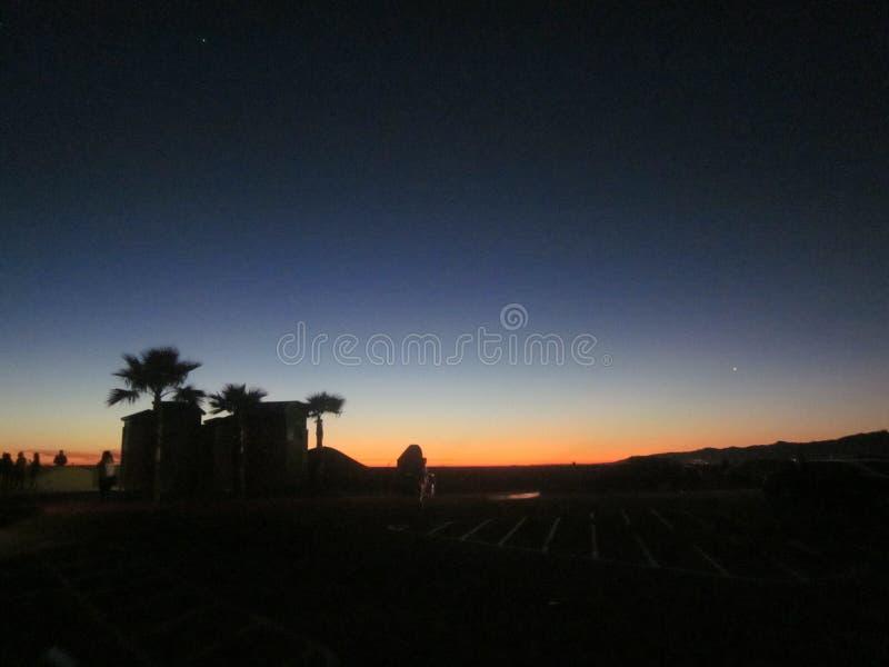 Puesta del sol del estacionamiento en la playa imagen de archivo libre de regalías