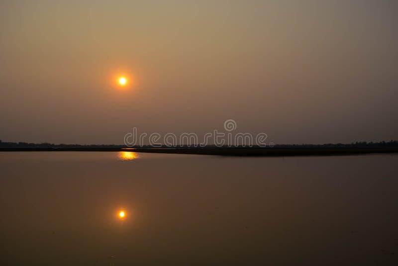 puesta del sol gemela foto de archivo libre de regalías