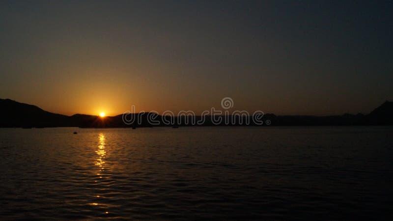 Puesta del sol - lago Pichhola fotografía de archivo libre de regalías