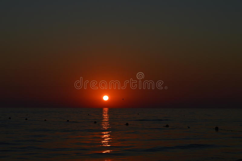 Puesta del sol, mar, océano imagenes de archivo