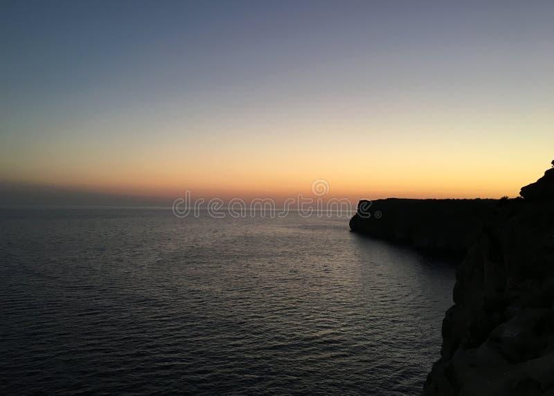 Puesta del sol Menorca foto de archivo
