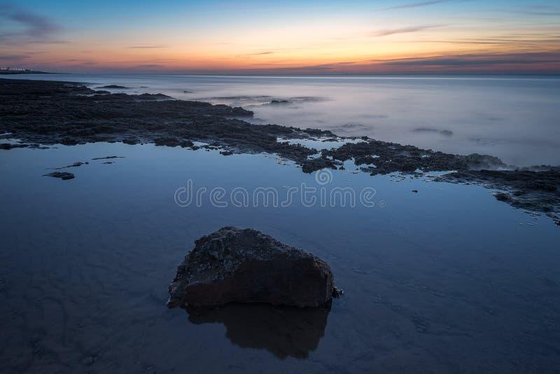 Puesta del sol Norfolk Reino Unido de la playa de Hunstanton imagenes de archivo