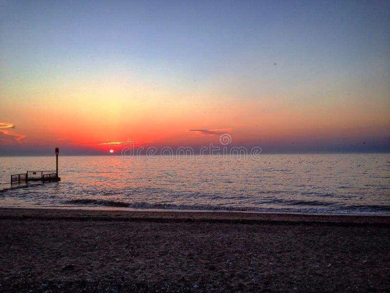 Puesta del sol Norfolk U de la playa K fotos de archivo
