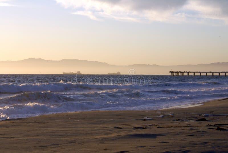 Puesta del sol sobre la playa de Hermosa imágenes de archivo libres de regalías