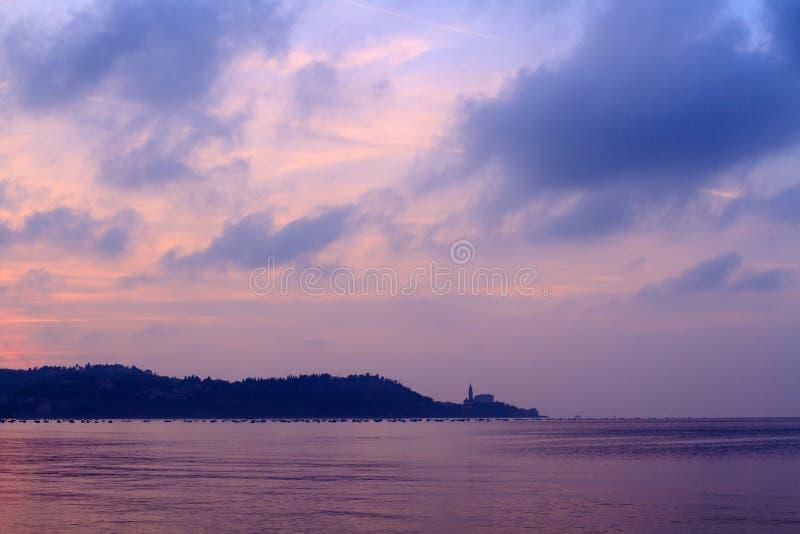 Puesta del sol sobre Piran foto de archivo libre de regalías