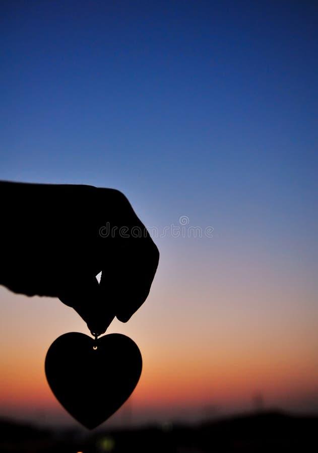 Puesta del sol y amor foto de archivo