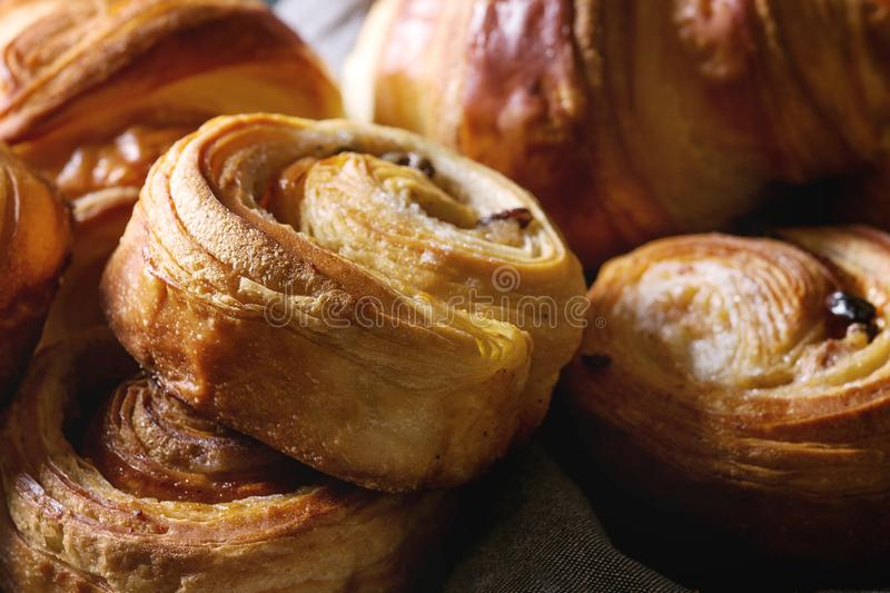 Puff pastry buns. Variety of homemade puff pastry buns cinnamon rolls and croissant. Close up stock photos