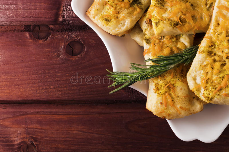Puff pastry with cheese and herbes de Provence on wooden planks toned selective focus royalty free stock images