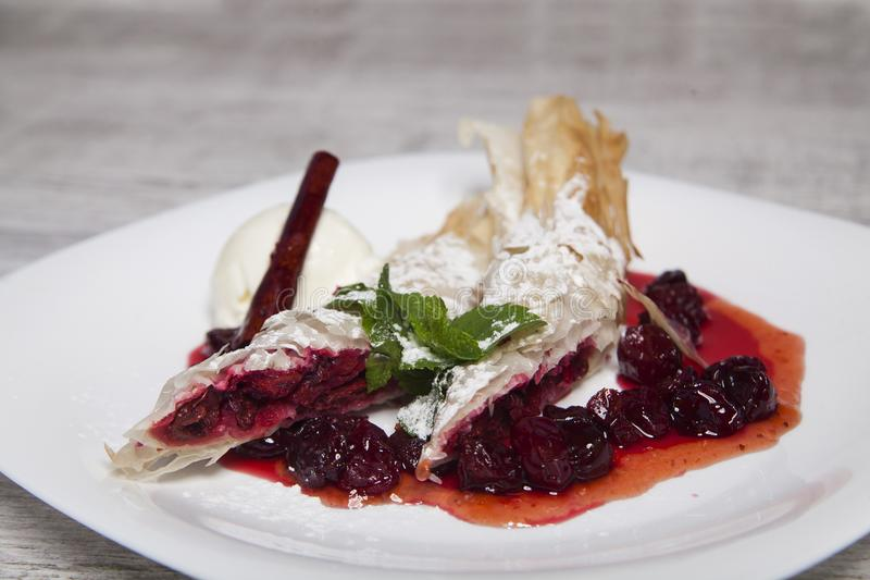 Puff pastry with cherry filling stock image