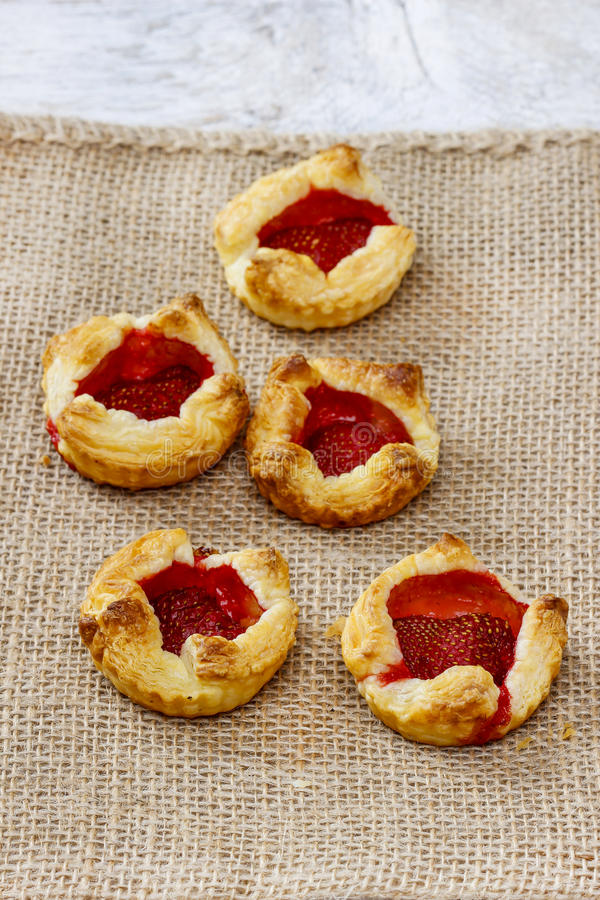Puff pastry with fresh ripe strawberries stock photography