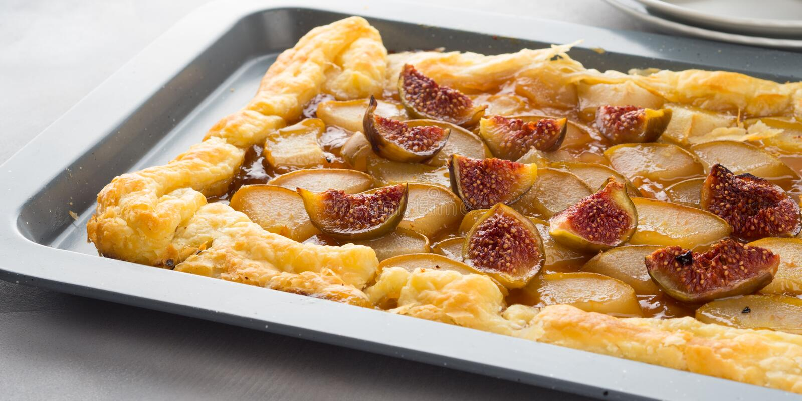 Puff pastry pie with pears and figs royalty free stock photography