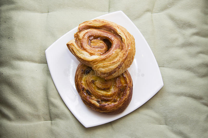 Puff pastry rolls with cinnamon royalty free stock photos