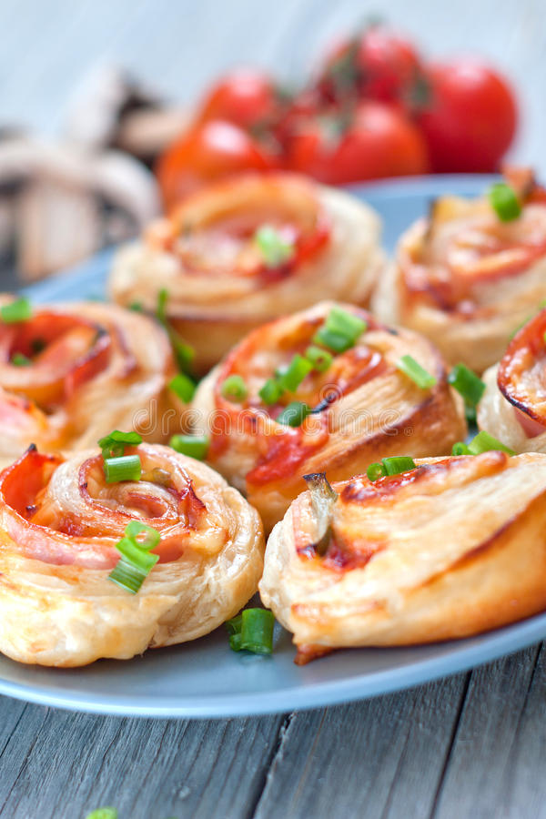 Puff pastry rolls with ham and chese. Baked snacks royalty free stock photography