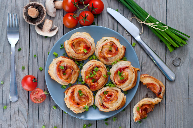 Puff pastry rolls with ham and chese. Baked snacks stock photography