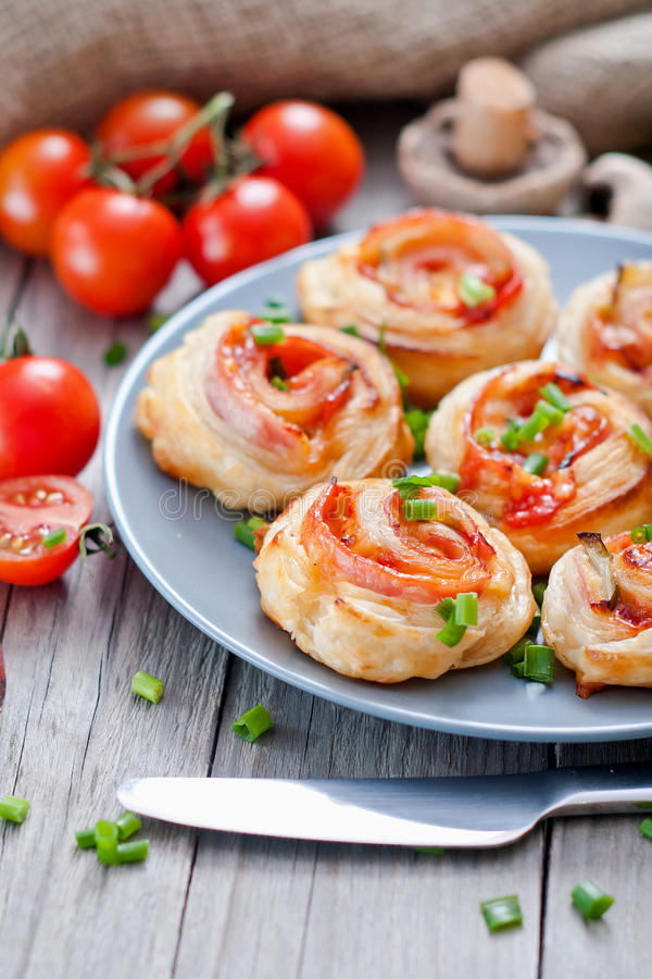 Puff pastry rolls with ham and chese. Baked snacks royalty free stock photo