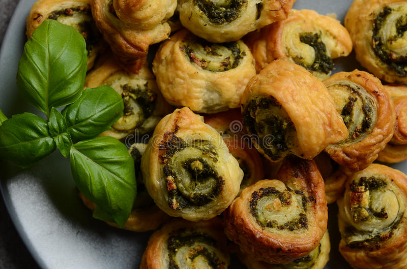 Puff pastry rolls with spinach and greek cheese filling royalty free stock photo