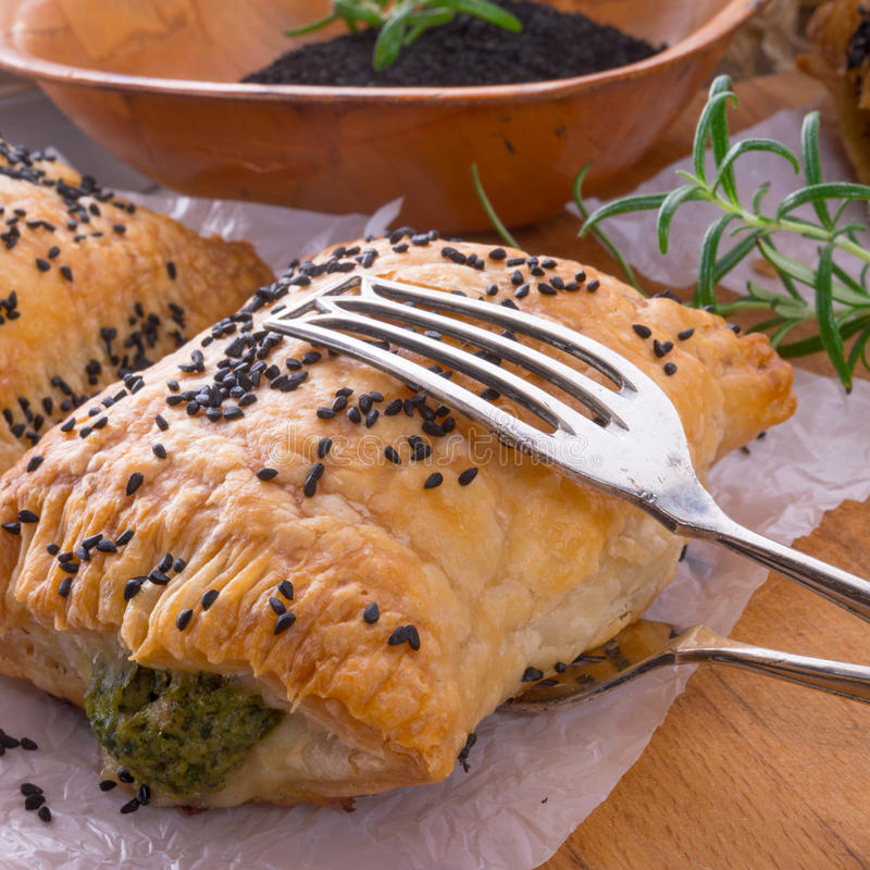 Puff pastry with spinach filling stock images