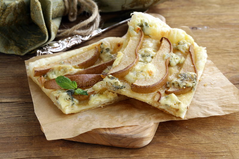 Puff pastry tart with blue cheese stock images