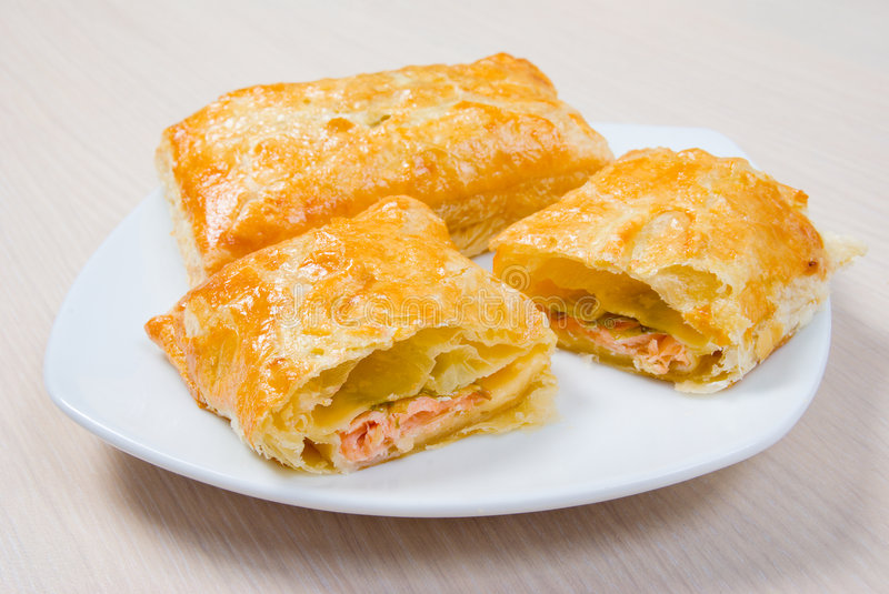 Puff pastry with verdure and salmon royalty free stock image
