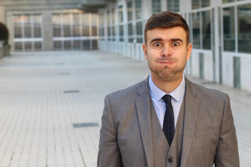 Puffed businessman feeling bloated with copy space stock photos