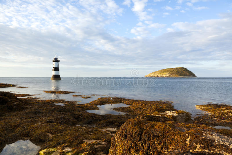 Puffin Island and Penmon Point Lighthouse. North Wales royalty free stock image