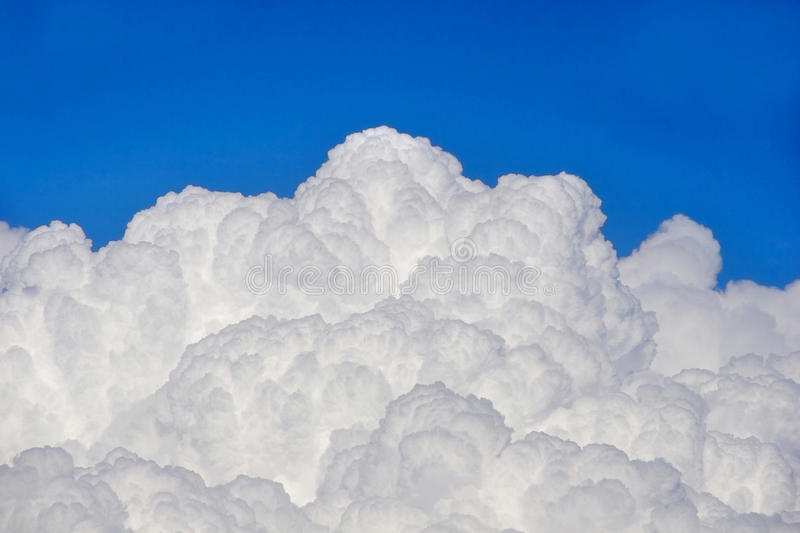 Puffy clouds stock photos