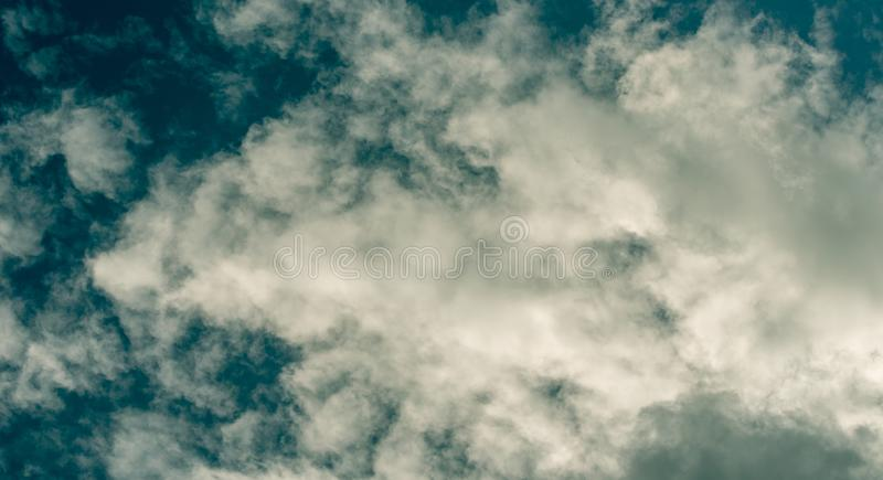 Puffy Clouds Background. Fluffy puffy clouds background with sun shine stock photography
