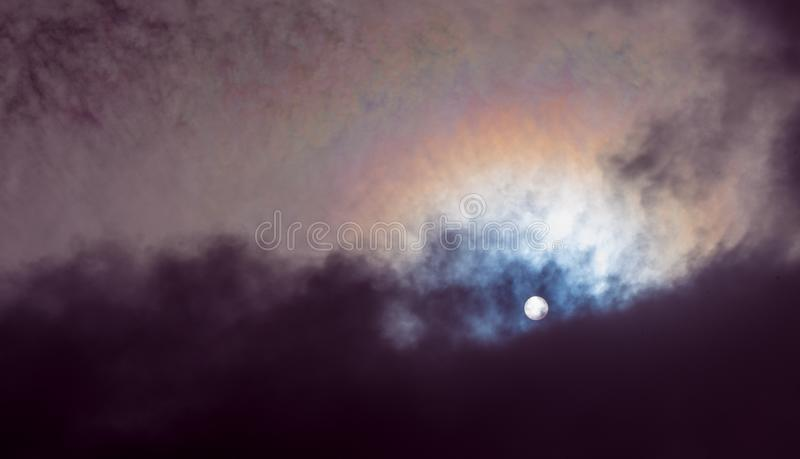 Puffy Clouds Background. Fluffy puffy clouds background with sun shine royalty free stock photo