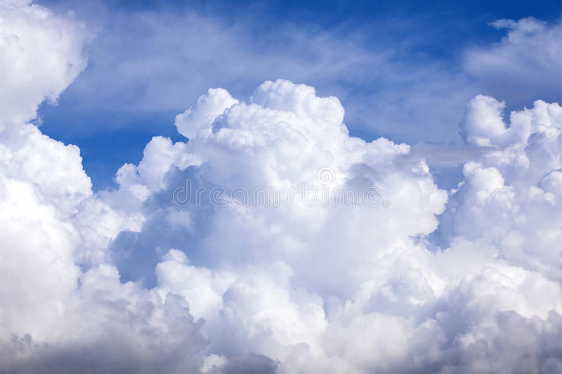 Puffy clouds blue sky stock photos