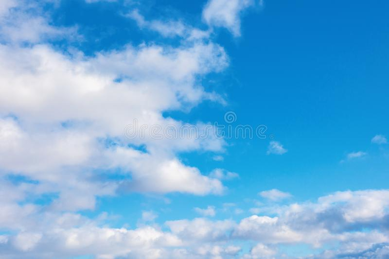 Puffy clouds on the blue winter sky royalty free stock photos