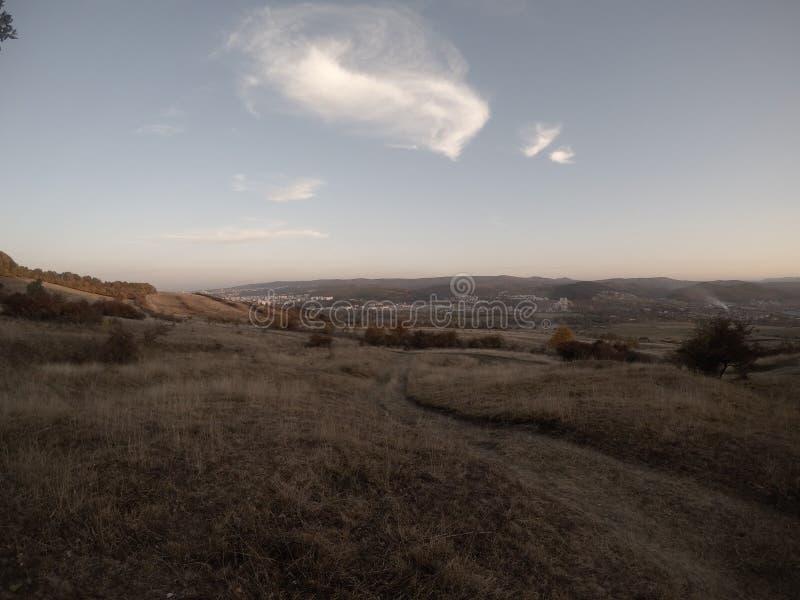 Puffy clouds in Floresti stock photo