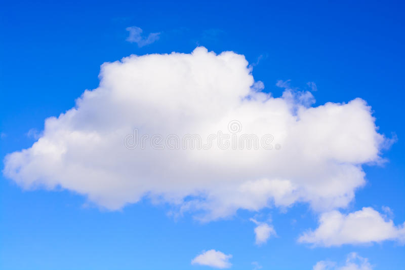 Puffy white cloud on blue sky. One white fluffy Cumulus cloud against a light blue clear sky close-up entirely. stock images