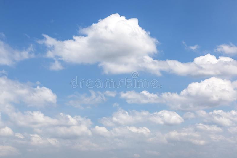 Puffy White Clouds in Blue Sky for Natural Background stock image
