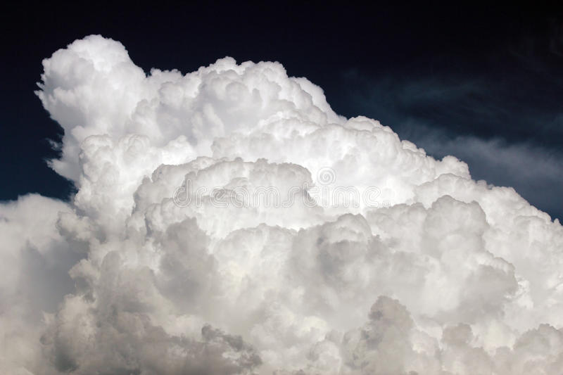 Puffy White Monsoon Cloud. Beautiful puffy, white monsoon storm cloud builds to a froth on hot, summer day in Tucson, Arizona royalty free stock photography