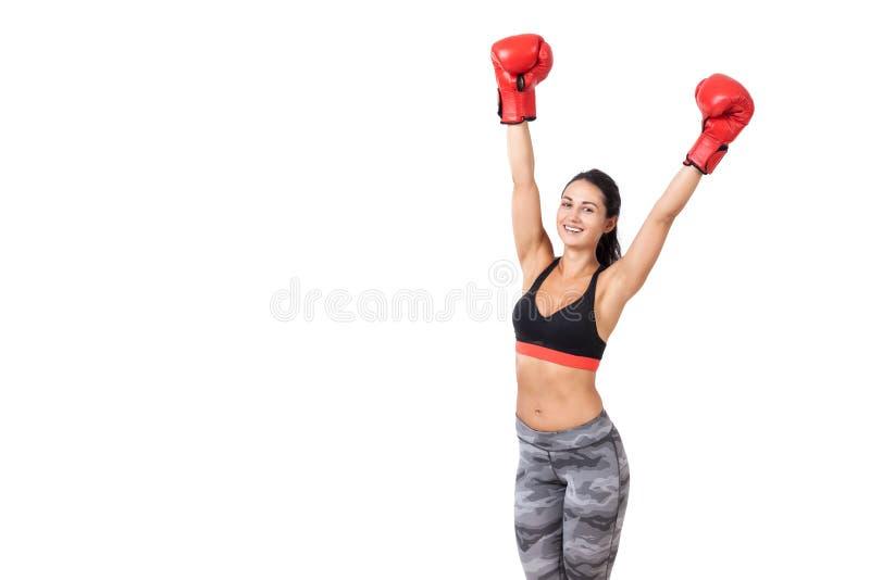 Pugile della donna che celebra la sua vittoria immagini stock