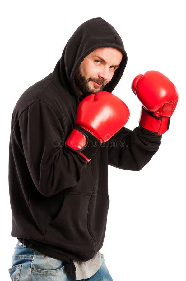 Pugilista amador que veste um hoodie e luvas fotos de stock royalty free