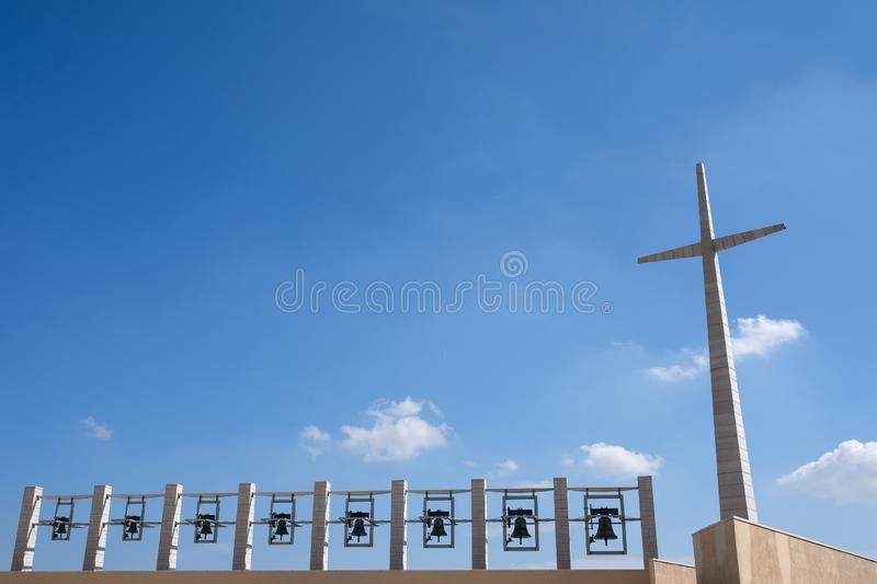 The Padre Pio Shrine at Santa Maria delle Grazie in San Giovanni Rotondo, Italy designed by Renzo Piano. Photo shows bells, cross royalty free stock photos