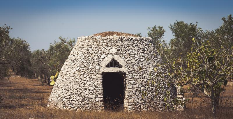 Puglia Region, Italy. Traditional warehouse made of stone. This traditional warehouse is named Furnieddhu in local dialect. All structure made of stone, used to stock photo