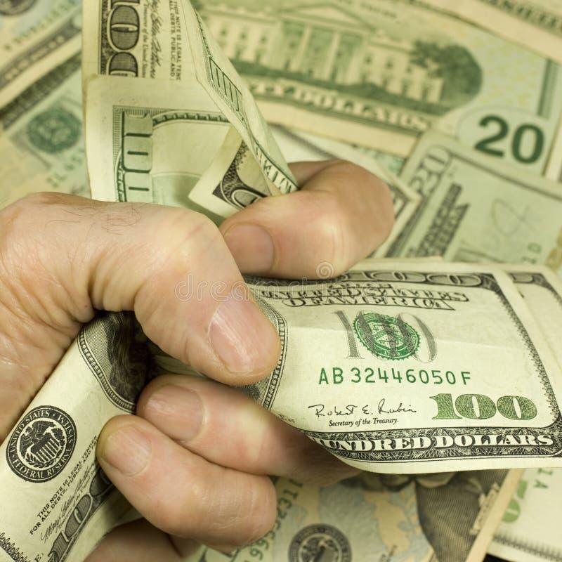 Pugno dei soldi immagini stock
