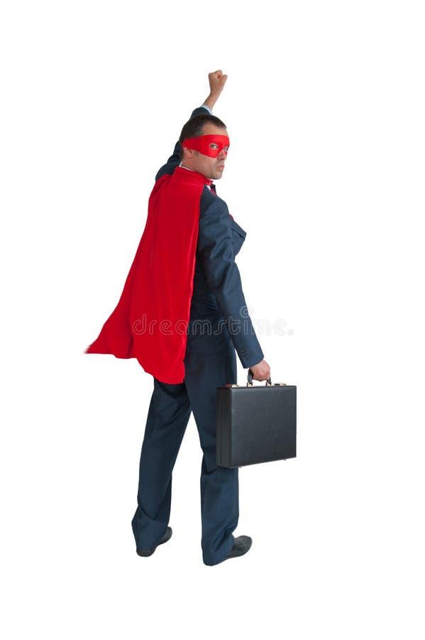Pugno dell'uomo d'affari del supereroe che pompa sul bianco fotografia stock
