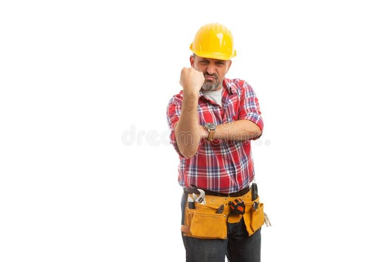 Pugno di rappresentazione del costruttore come gesto osceno fotografia stock libera da diritti
