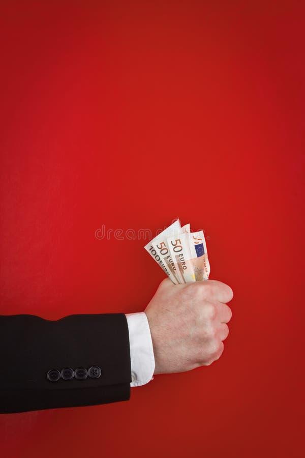 Pugno di soldi immagini stock