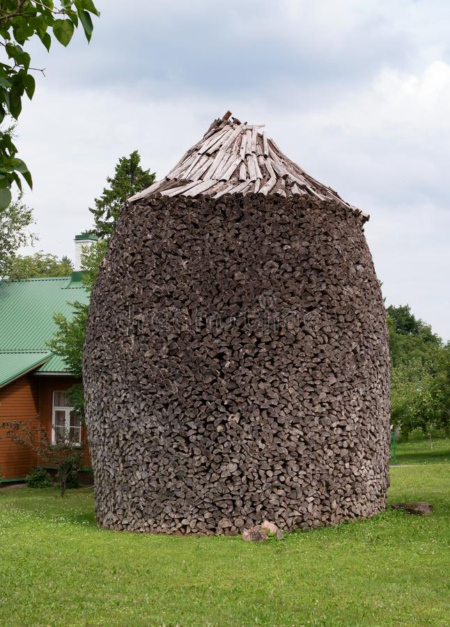 The Puhtitsa Dormition convent. Kuremae, Estonia. Baltic country. Woodpile. Firewood is laid in the form of stacks. The royalty free stock photo