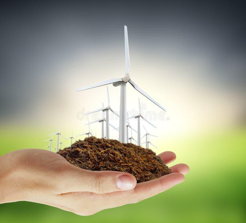Puissance d'Eco, turbines de vent à disposition illustration stock