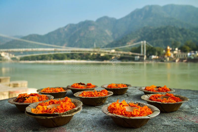 Puja flowers offering at the bank of Ganges river royalty free stock image