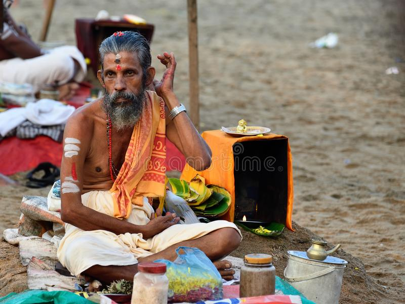 Puja in India, brahmin. VARKALA, KERALA, INDIA - 18 MARCH 2015: Traditional morning Puja in the holy place on Varkali beaches in the Kerala state in India stock photos