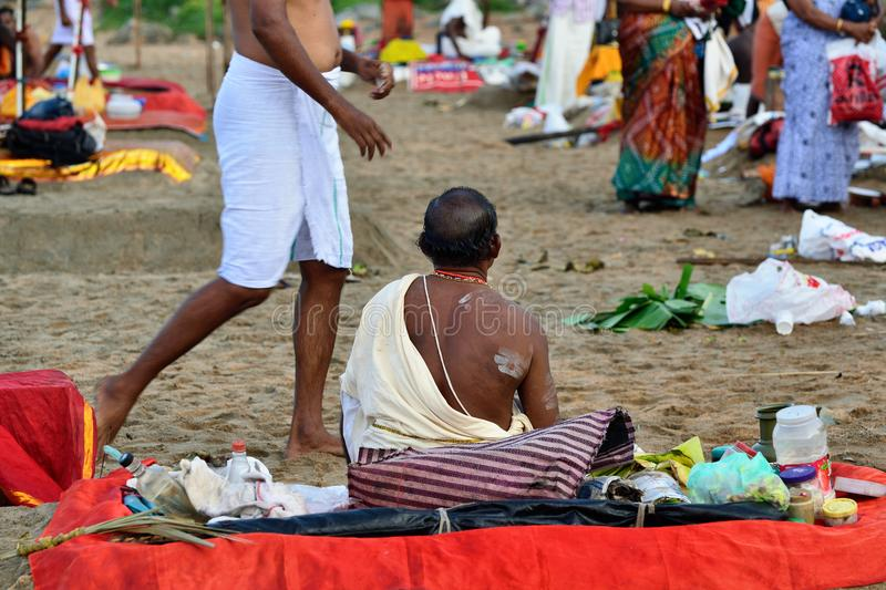 Puja in India, brahmin. VARKALA, KERALA, INDIA - 18 MARCH 2015: Traditional morning Puja in the holy place on Varkali beaches in the Kerala state in India royalty free stock image